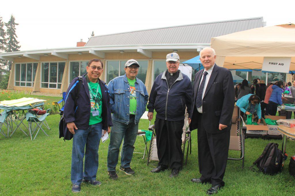 Rev Larry Pederson, Mayor Norman Mayer, Greg P and Henry Gutierrez, Edm Area Leader